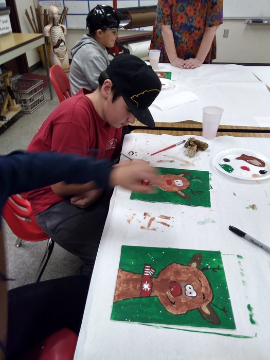 Students painting reindeer